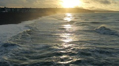 View of waves on the sea, Normandy. Cloudy weather with sunset on a coast. Azure Stock Footage