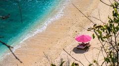 Lila Sunbed on Beautiful White Sand. Clear Blue Ocean, Atuh Beach, Nusa Penida Stock Photos