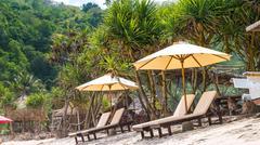 Sunbed on White Sand under Palms - Atuh Beach, Nusa Penida, Bali, Indonesia Stock Photos