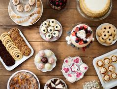 Table with cakes, cookies, cupcakes, tarts and cakepops Stock Photos