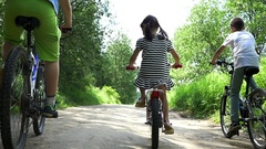 Children Ride Bikes Outdoors, Slow Motion, Back View Stock Footage