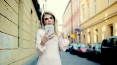 Thoughtful girl looking lost and checking something on tablet in the alley Stock Footage