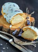 Eclair with a delicate lavender cream. Stock Photos