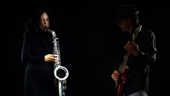 Attractive saxophonists and guitarist playing together Stock Footage