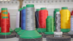 Spools of threads in sewing factory Stock Footage