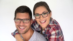Portrait of middle-aged couple with eyeglasses, isolated Stock Footage