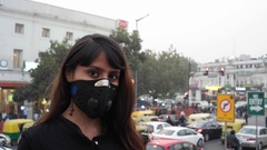 Woman wearing a pollution mask in Delhi, India after health warnings Stock Footage