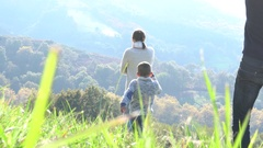 Happy family walking in countryside on autumnal week-end Stock Footage