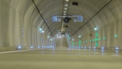 First cars ride through the newly open underground tunnel Stock Footage