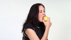 Attractive woman eats passionately an apple Stock Footage