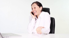 Attractive woman talking on phone excitedly at workplace in office Stock Footage