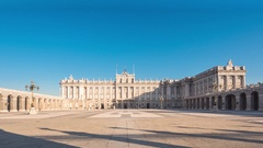 Madrid royal palace timelapse sun lights the facade Stock Footage