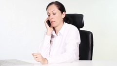 Attractive woman in office leading worried telephoning Stock Footage