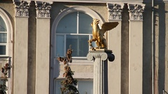 Statue of a golden griffin. City. Building. Sunny day. Russia. Stock Footage