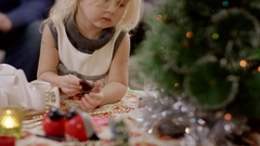 Daughter eating candies at christmas celebration Stock Footage
