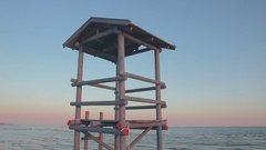 Beach the afternoon, lifeguard tower at the foreground Stock Footage