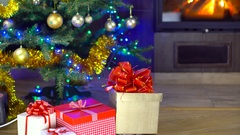 Cute girl open present at christmas time Stock Footage