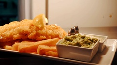 French fries and Fish, Kitchen of Restaurant. Salt and Pepper. Fish and Chips Stock Footage