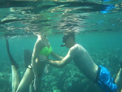 Couple snorkeling in sea, super slow motion 240fps Stock Footage