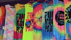 Colorful T-shirts sold on island during full moon party, Koh Phangan, Thailand Stock Footage