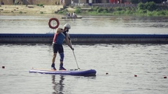 A man in a boat rowing oar Stock Footage