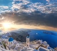 Old Town of Thira on the island Santorini, famous church against colorful sunset Stock Photos