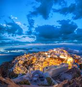 Oia village in the evening on Santorini island in Greece Stock Photos