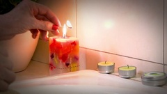 Lighting Candles for a Salt Bath Stock Footage