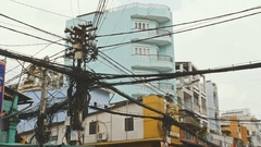 The web of power lines on the streets of Ho Chi Minh City 2 Stock Footage