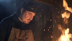 Blacksmith kindle a fire in the hearth Stock Footage