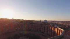 Brick Tower and Church at Sunset  Copter Shooting Stock Footage