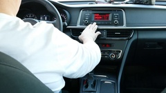 The driver is preparing for a trip, adjusts the seat, mirrors, steering wheel Stock Footage
