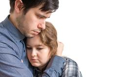 Young man is hugging his sad girlfriend. Consoling and compassion concept. Stock Photos