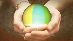 The colorful ball revolves in man hands Stock Footage