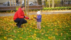 Happy Family Father and Child Daughter on a Walk in the Autumn Leaf Fall in Park Stock Footage
