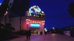 People Entering Aquarius Casino Resort At Night- Laughlin NV Stock Footage