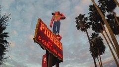 Pioneer Gambling Hall Cowboy Sign At Dusk- Laughlin Nevada Stock Footage