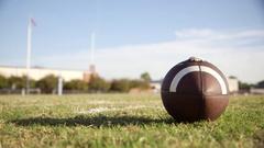 Football Player Picks up Ball Stock Footage
