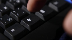 Finger pressing Windows button  Stock Footage