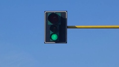 Traffic light against clear blue sky Stock Footage