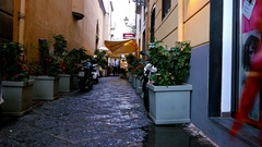 Walking on a street in Sorrento, Italy, cars, people and shop windows Stock Footage