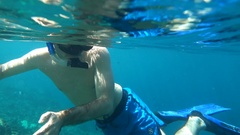 Young man snorkeling in sea, super slow motion 120fps Stock Footage