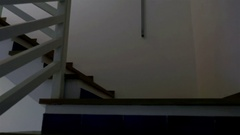 Smooth movement floating up stairs with no light Stock Footage