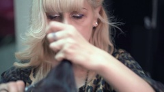 Hairstylist cuts the hair to a young girl with a professional scissors Stock Footage