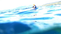 Young man snorkeling in sea, super slow motion 240fps Stock Footage