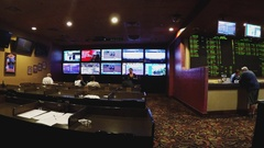 Wide Shot Sports Betting Area In Gambling Casino Stock Footage