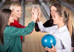 Young group of female friends in bowling alley. Kuvituskuvat