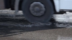 A puddle of water on the road Stock Footage