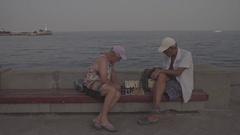 Medium frame. Chess. Game of chess. Baywalk. Sea. Retired. Summer. Russia. Stock Footage