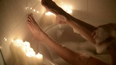 Legs of a beautiful young woman who takes a bath Stock Footage